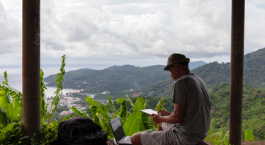 Man working on a laptop in the jungle